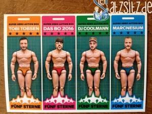 Postkarte, die 5 Sterne Deluxe als Action-Wrestling Figuren zeigt